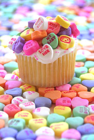 Candy hearts surround a homemade cupcake