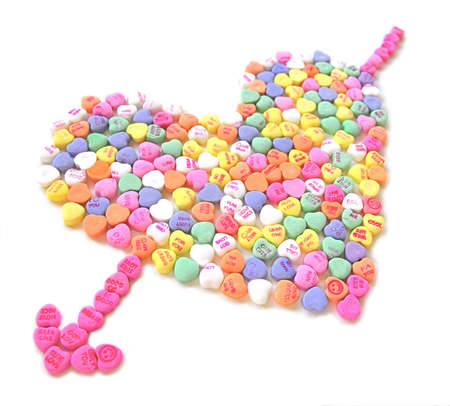 Candy Heart with arrow on white background photo