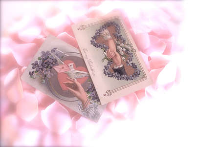Soft Focus, old fashioned cards on a bed of pink roses