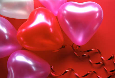 Pink and Red Heart Shaped Balloons on a red background photo