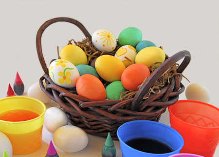 Basket of easter eggs and food coloring dye photo