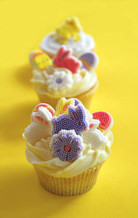 Easter bunny cupcakes on a yellow background photo