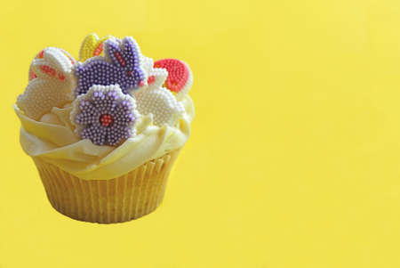 Easter bunny cupcakes on a yellow background Stock Photo - 4474487