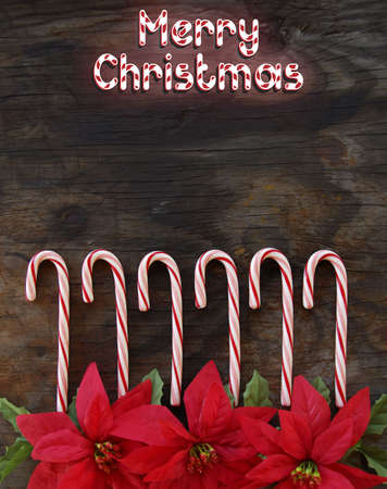 Candy cane Merry Christmas on old, weathered wood. photo