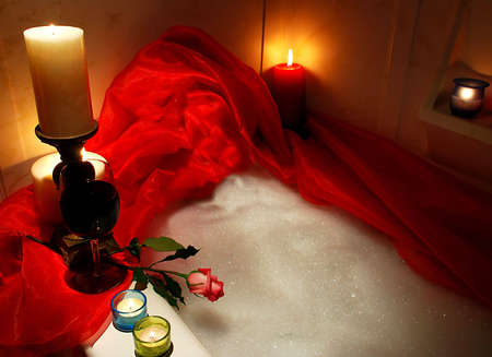 bathtube surrounded with candles, romantic atmosphere photo