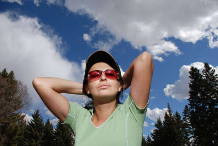 portrait of a woman, jogging outdoors over blue sky photo