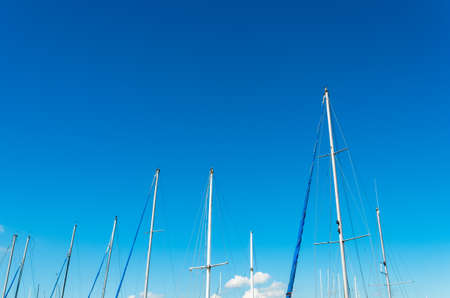 mast: Sailboat mast over a blue sky background