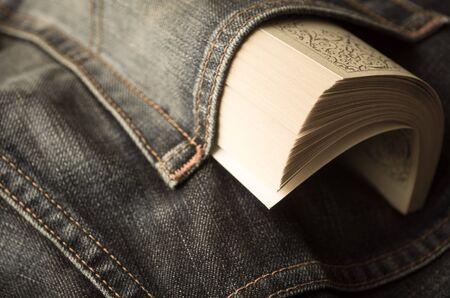 book concept: Paperback in jeans pocket