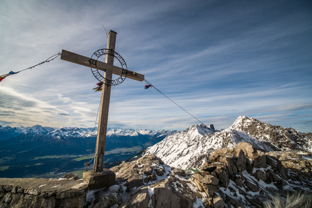 Cross on top peak of Nordkette mountain, Tyeol, Innsbruck, Austria.