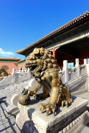 Bronze lion statue in front of Gate of Supreme Harmony in Forbidden City, Beijing, China photo