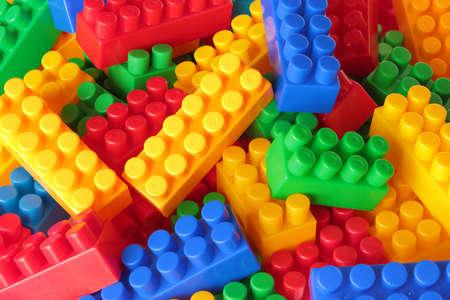 Toy color bricks background. Close-up. photo