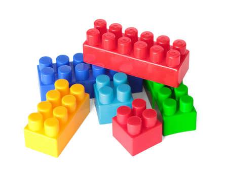 Toy color bricks on white background. Isolated. photo