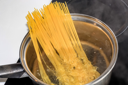 boiling: boiling spaghetti noodles in the pot Stock Photo