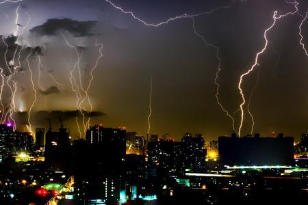 house of god: Dramatic thunder storm lightning bolt on the horizontal sky and city scape