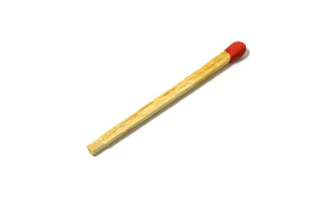 unlit: Close up of a red match stick isolated on a white background