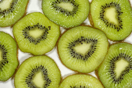 Close up top view macro kiwi fruit slices for background Stock Photo