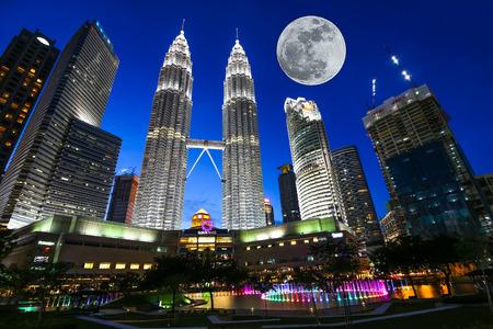 KUALA LUMPUR, MALAYSIA - July 18, 2016: Petronas Twin Towers with Musical fountain at night in Kuala Lumpur, Malaysia