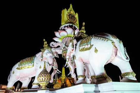 Three Erawan statues and symbols King, In front of Grand Palace, Emerald Buddha Temple, Wat Phra Kaew in Bangkok The statues of White Elephants in front of the Grand Palace or Emerald Buddha Temple. Stock Photo