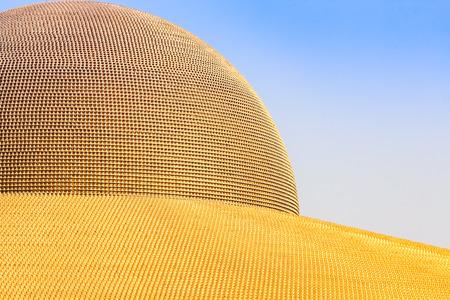 dhamma: PATHUM THANI - February 11: Million golden Buddha figurine of Dhammakaya Pagoda at Wat Dhammakaya on February 11, 2017 in Pathum Thani, Thailand.