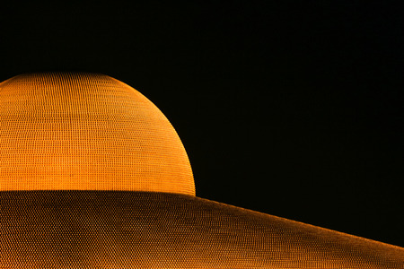dhamma: PATHUM THANI - February 11: Million golden Buddha figurine of Dhammakaya Pagoda at Wat Dhammakaya at night on February 11, 2017 in Pathum Thani, Thailand. Editorial
