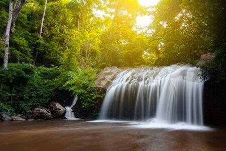 Beautiful waterfall with sunlight in jungle, Haew Suwat Waterfall