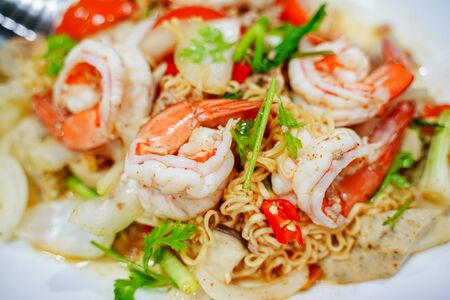 Spicy seafood salad with instant noodle. Thai food style. Reklamní fotografie