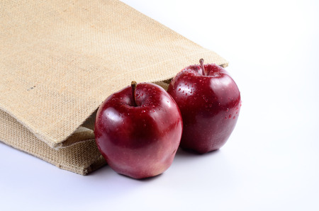 sackcloth: Red apples with sackcloth