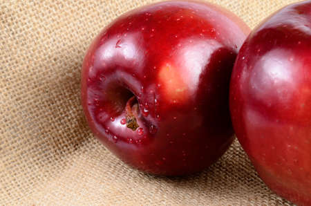 sackcloth: Close up red apples on sackcloth Stock Photo