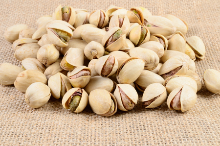 Pistachio nut on a sackcloth Imagens