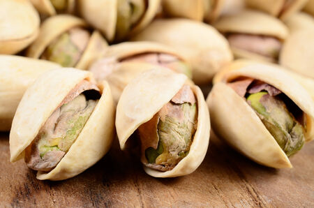 Pistachio nut on a wooden board