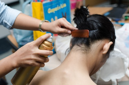 hairspray: Hair stylist setting up hair with hairspray