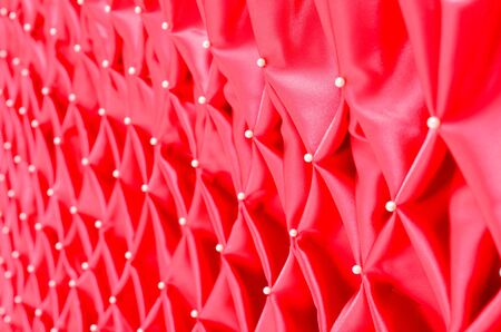 dimond: red satin folded pattern fabric art Stock Photo