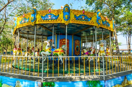 joyfull: carousel horse in the playground Stock Photo