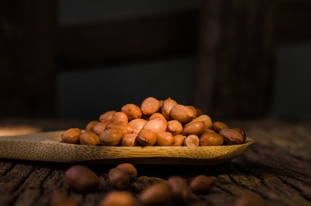 Raw peanut on wooden background photo