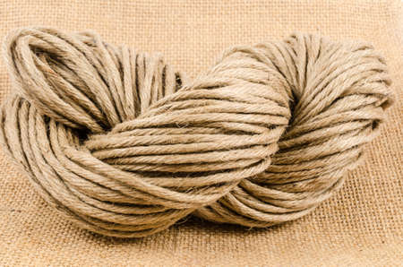 sack cloth: roll of rope on sack cloth,burlap Stock Photo