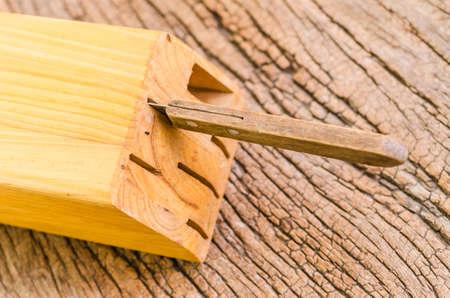 wooden insert: wooden knife block on wooden background Stock Photo