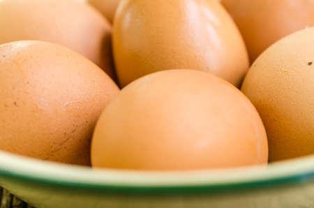 protien: Eggs in bowl on wooden board
