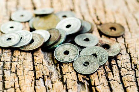 antique coins: antique coins on wooden background