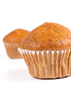 brown banana: Two brown banana muffin in paper cupcake holder isolated on white background
