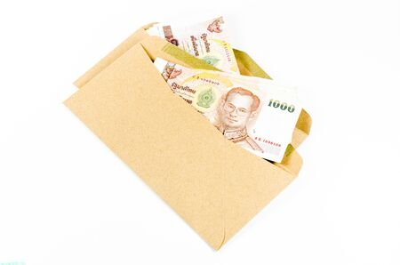 develope: Stack of thai banknote in brown develope  isolated on white background
