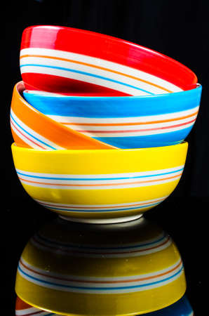 receptacle: set of bowl with black surface background