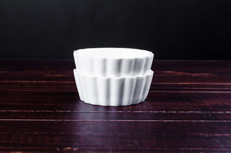 receptacle: white porcelain on wooden board background