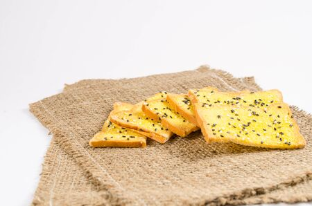 sack cloth: crisp bread with margarine and sesame on sack cloth Stock Photo