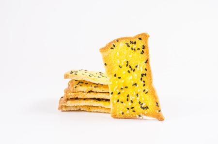 sesame cracker: crispbread with margarine and sesame isolated on white background Stock Photo