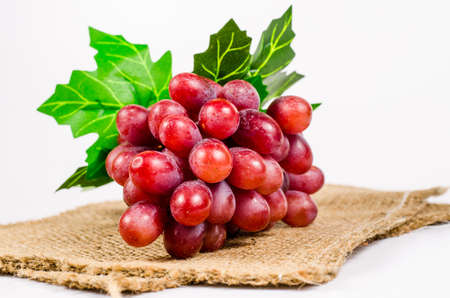sack cloth: Ripe red grape isolated on sack cloth background Stock Photo