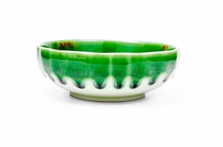 receptacle: empty green bowl on white background