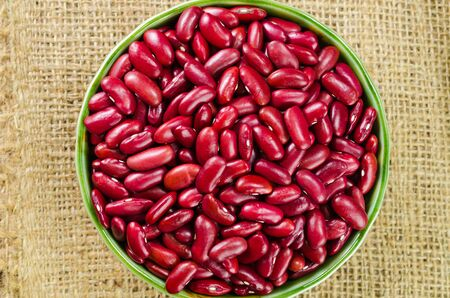 sack cloth: Red bean in ceramic bowl on sack cloth Stock Photo