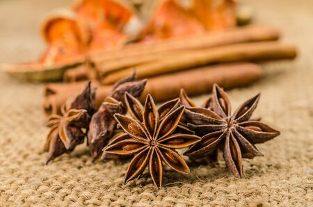 asian flavors: Star anise and cinnamon herb on sackcloth