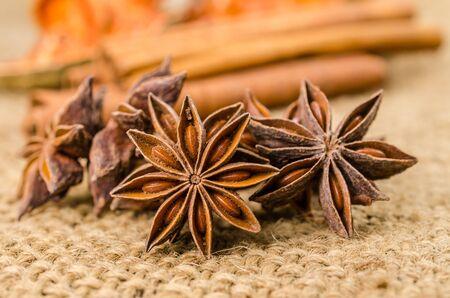 Star anise and cinnamon herb on sackcloth