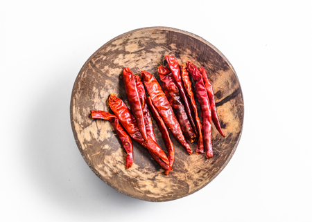 red chilli: dried red chilli in coconut shell on white background